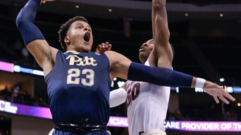 Pittsburgh's Shamiel Stevenson (23) goes up for a shot as Duquesne's Eric Williams Jr. (50) defends during the first half of an NCAA college basketball game, Friday, Dec. 1, 2017, in Pittsburgh. Pittsburgh won 76-64. (AP Photo/Keith Srakocic)