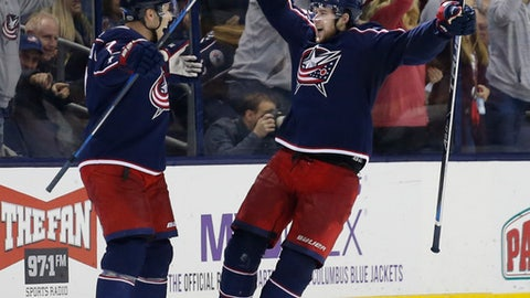 Columbus Blue Jackets' Josh Anderson, right, celebrates his goal against the Anaheim Ducks with teammate Jack Johnson during the third period of an NHL hockey game Friday, Dec. 1, 2017, in Columbus, Ohio. (AP Photo/Jay LaPrete)