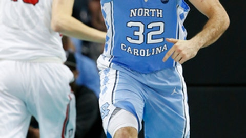 North Carolina forward Luke Maye (32) signals after scoring a basket against Davidson during the second half of an NCAA college basketball game in Charlotte, N.C., Friday, Dec. 1, 2017. (AP Photo/Jason E. Miczek)