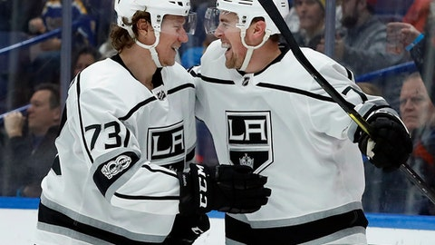 Los Angeles Kings' Tyler Toffoli (73) is congratulated by Tanner Pearson after scoring during the third period of an NHL hockey game against the St. Louis Blues on Friday, Dec. 1, 2017, in St. Louis. The Kings won 4-1. (AP Photo/Jeff Roberson)