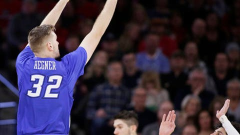 Creighton forward Toby Hegner (32) shoots over Gonzaga guard Josh Perkins (13) during the first half of an NCAA college basketball game in Spokane, Wash., Friday, Dec. 1, 2017. (AP Photo/Young Kwak)