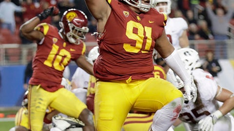 Southern California defensive tackle Brandon Pili (91) and teammates celebrate after stopping Stanford on fourth down during the second half of the Pac-12 Conference championship NCAA college football game in Santa Clara, Calif., Friday, Dec. 1, 2017. (AP Photo/Marcio Jose Sanchez)