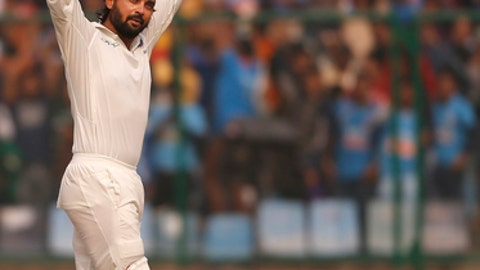 India's Murali Vijay celebrates after scoring a century during the first day of their third test cricket match against Sri Lanka in New Delhi, India, Saturday, Dec. 2, 2017. (AP Photo/Altaf Qadri)