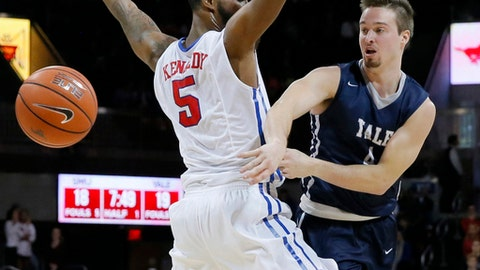 FILE - In this Nov. 22, 2015 FILE photo, Yale's Jack Montague, right, passes the ball around SMU's Markus Kennedy during an NCAA college basketball game in Dallas. Court documents show that Yale alumni are helping fund a lawsuit filed by Montague, who was expelled from the school for sexual misconduct.  Montague told attorneys in a court deposition that between $25,000 and $30,000 has been raised from alumni to help fund the lawsuit, in which he claims he was wrongly expelled in 2016. He is seeking monetary damages and to be readmitted to the Ivy League school.  (AP Photo/Tony Gutierrez, File)