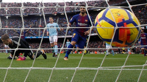 FC Barcelona's Luis Suarez, center right, scores during a Spanish La Liga soccer match between FC Barcelona and Celta Vigo at the Camp Nou stadium in Barcelona, Saturday, Dec. 2, 2017. (AP Photo/Manu Fernandez)
