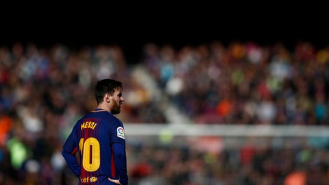 FC Barcelona's Lionel Messi looks on during a Spanish La Liga soccer match between FC Barcelona and Celta Vigo at the Camp Nou stadium in Barcelona Saturday Dec. 2 2017
