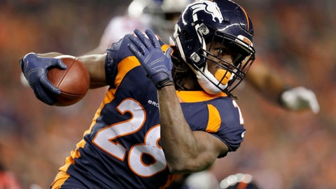 """FILE - In this Oct. 15, 2017, file photo, Denver Broncos running back Jamaal Charles runs with the ball during the first half of an NFL football game against the New York Giants in Denver. Charles no longer hides the challenges of his childhood that included relentless teasing over his disability and the lifeline provided by Special Olympics, where he learned he could overcome any obstacle. Now boasting the highest career rushing average in NFL history, Charles will wear custom cleats this weekend to spread his message as part of the NFL's """"My Cause My Cleats"""" campaign.  (AP Photo/Joe Mahoney, FIle)"""