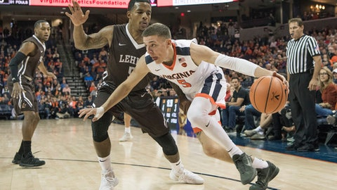 Virginia's Kyle Guy (5) drives past Lehigh's Lance Tejada (5) during the first half of an NCAA college basketball game in Charlottesville, Va., Saturday, Dec. 2, 2017. (AP Photo/Lee Luther Jr.)