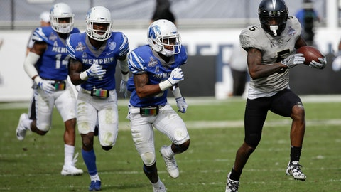 Central Florida wide receiver Dredrick Snelson, right, runs for yardage past Memphis defensive back Terrell Carter, center, during the first half of the American Athletic Conference championship NCAA college football game, Saturday, Dec. 2, 2017, in Orlando, Fla. (AP Photo/John Raoux)