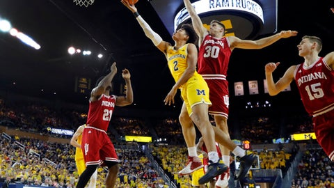 Michigan guard Jordan Poole (2) drives on Indiana forward Collin Hartman (30) in the second half of an NCAA basketball game in Ann Arbor, Mich., Saturday, Dec. 2, 2017. (AP Photo/Paul Sancya)