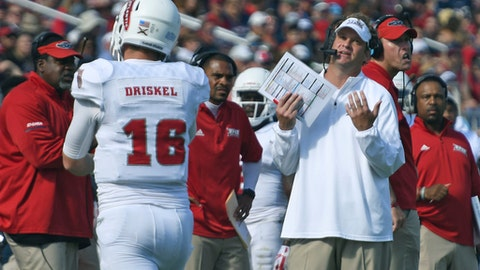 Florida Atlantic head coach Lane Kiffin speaks to his players during the first half of the Conference USA championship NCAA college football game against North Texas, Saturday, Dec. 2, 2017, in Boca Raton, Fla. (Jim Rassol/South Florida Sun-Sentinel via AP)