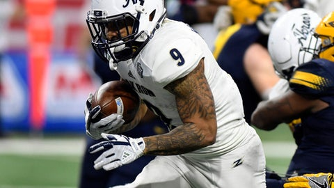 Akron running back Manny Morgan (9) runs for a touchdown against Toledo during the third quarter of the Mid-American Conference championship NCAA college football game, Saturday, Dec. 2, 2017, in Detroit. (AP Photo/Jose Juarez)