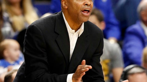Harvard head coach Tommy Amaker urges his team on during the first half of an NCAA college basketball game against Kentucky, Saturday, Dec. 2, 2017, in Lexington, Ky. (AP Photo/James Crisp)