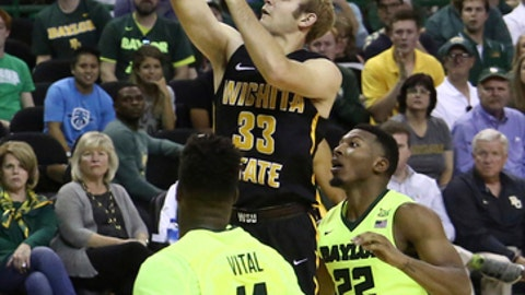 Wichita State guard Conner Frankamp, center, scores over Baylor forward Mark Vital, left, and guard King McClure, right, in the second half of an NCAA college basketball game, Saturday, Dec. 2, 2017, in Waco, Texas. Wichita State won 69-62. (AP Photo/Rod Aydelotte)