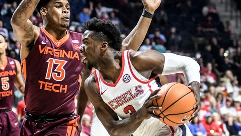 Mississippi's Ternce Davis (3) drives against Virginia Tech's Ahmed Hill (13) during an NCAA college basketball game, Saturday, Dec. 2, 2017,  in Oxford, Miss.  (Bruce Newman/The Oxford Eagle via AP)