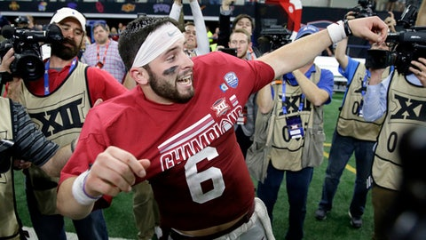 Oklahoma quarterback Baker Mayfield celebrates as he puts on his championship t-shirt after their Big 12 Conference championship NCAA college football game against TCU on Saturday, Dec. 2, 2017, in Arlington, Texas. (AP Photo/Tony Gutierrez)