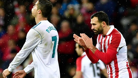 Real Madrid's Cristiano Ronaldo, left, laments missing a goal beside Athletic Bilbao's Mikel Balenziaga, during the Spanish La Liga soccer match between Athletic Bilbao and Real Madrid at San Mames stadium, in Bilbao, northern Spain, Saturday, Dec. 2, 2017. Real Madrid tied the mach 0-0. (AP Photo/Alvaro Barrientos)