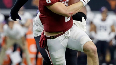 Oklahoma quarterback Baker Mayfield, front, is chased out of the pocket by TCU defensive tackle Ross Blacklock, rear, in the second half of the Big 12 Conference championship NCAA college football game, Saturday, Dec. 2, 2017, in Arlington, Texas. (AP Photo/Tony Gutierrez)