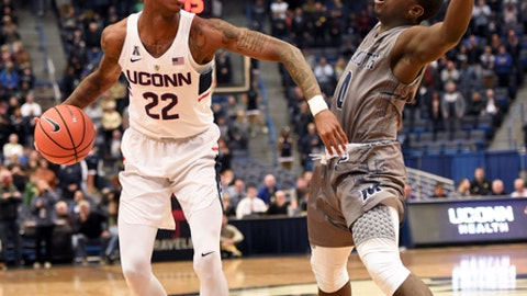 Connecticut's Terry Larrier runs up against Monmouth's Ray Salnave in the first half of an NCAA college basketball game Saturday, Dec. 2, 2017, at the XL Center in Hartford, Conn. (AP Photo/Stephen Dunn)