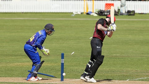 New Zealand-born England cricket player Ben Stokes is bowled for 2 runs by Amaru Kitchen as wicketkeeper Derek de Boorder looks on during provincial cricket team Canterbury in Rangiora, New Zealand, Sunday, Dec. 3, 2017. England cricketer Ben Stokes will play for Canterbury province in New Zealand's domestic one-day competition starting on Sunday, despite being barred from international play as he waits to learn whether he will be charged over his part in a nightclub assault in September. (AP Photo/Martin Hunter)
