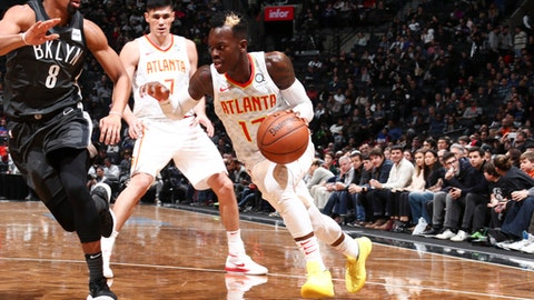 BROOKLYN, NY - DECEMBER 2: Dennis Schroder #17 of the Atlanta Hawks handles the ball against the Brooklyn Nets on December 2, 2017 at Barclays Center in Brooklyn, New York. NOTE TO USER: User expressly acknowledges and agrees that, by downloading and or using this Photograph, user is consenting to the terms and conditions of the Getty Images License Agreement. Mandatory Copyright Notice: Copyright 2017 NBAE (Photo by Nathaniel S. Butler/NBAE via Getty Images)