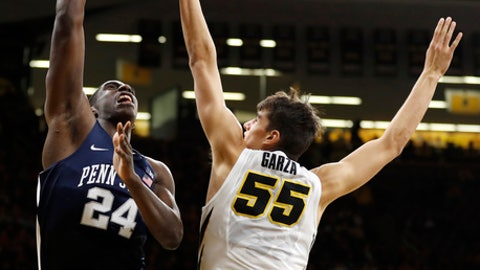 Penn State forward Mike Watkins (24) shoots over Iowa forward Luka Garza (55) during the first half of an NCAA college basketball game, Saturday, Dec. 2, 2017, in Iowa City, Iowa. (AP Photo/Charlie Neibergall)