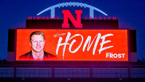 "The Memorial Stadium video board displays a ""Welcome Home"" message to new Nebraska football coach Scott Frost on Saturday, Dec. 2, 2017, in Lincoln, Neb. Frost, the native son who quarterbacked Nebraska to a share of the national championship 20 years ago, is returning to the Cornhuskers as coach after orchestrating a stunning two-year turnaround at Central Florida. (Francis Gardler/The Journal-Star via AP)"