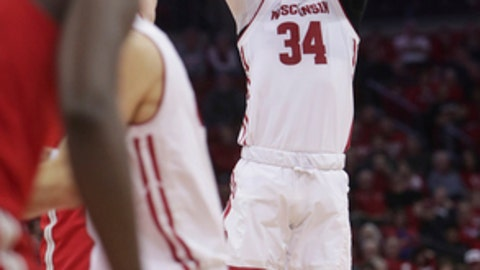 Wisconsin guard Brad Davison (34) hits a three-point basket in the second half of an NCAA college basketball game against Ohio State in Madison, Wis., Saturday, Dec. 2, 2017. (Amber Arnold/Wisconsin State Journal via AP)