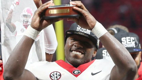 Georgia wide receiver Tyler Simmons holds his MVP trophy after the Southeastern Conference championship NCAA college football game against Auburn, Saturday, Dec. 2, 2017, in Atlanta. Georgia won 28-7. (AP Photo/John Bazemore)