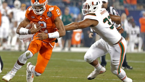 Clemson's Kelly Bryant (2) runs as Miami's Trent Harris (33) defends during the first half of the Atlantic Coast Conference championship NCAA college football game in Charlotte, N.C., Saturday, Dec. 2, 2017. (AP Photo/Bob Leverone)