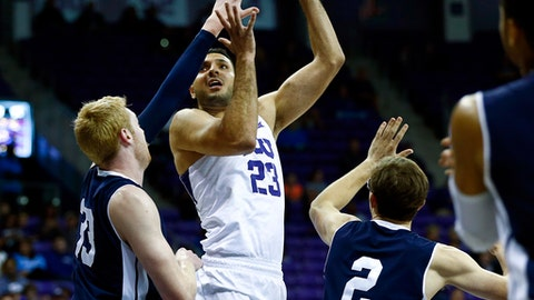 TCU forward Ahmed Hamdy-Mohamed (23) shoots over Yale forward Wyatt Yess (33) and guard Eric Monroe (02) in the first half of an NCAA college basketball game on Saturday, Dec. 2, 2017, in Fort Worth, Texas. (AP Photo/Ralph Lauer)