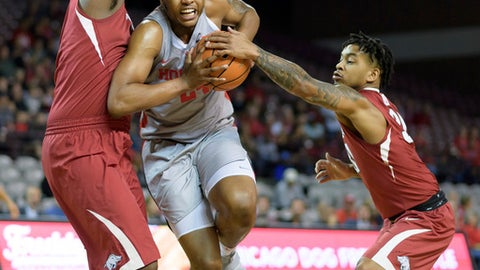 Arkansas' Anton Beard (31)  attempts to grab the ball from Houston's Breaon Brady (24) during the first half of an NCAA college basketball game, Saturday, Dec. 2, 2017 in Houston. (Wilf Thorne/Houston Chronicle via AP)