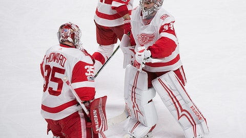 Detroit Red Wings goaltender Jimmy Howard (35) comes in to replace teammate Petr Mrazek during the second period of an NHL hockey game against the Montreal Canadiens, Saturday, Dec. 2, 2017 in Montreal. (Graham Hughes/The Canadian Press via AP)