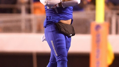 Boise State defensive end Curtis Weaver (99) celebrates a play during the first half of an NCAA college football game against Fresno State for the Mountain West championship in Boise, Idaho, Saturday, Dec. 2, 2017.  (Drew Nash/The Times-News via AP)