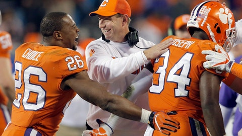 Clemson head coach Dabo Swinney, center, congratulates his players during the second half of the Atlantic Coast Conference championship NCAA college football game against Miami in Charlotte, N.C., Saturday, Dec. 2, 2017. (AP Photo/Bob Leverone)