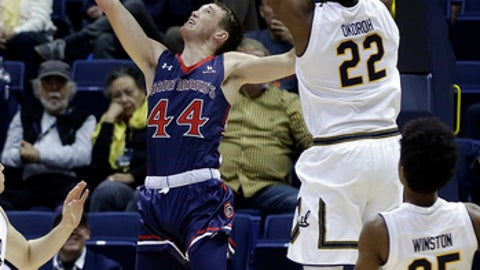 Saint Mary's Cullen Neal (44) lays up a shot past California's Kingsley Okoroh (22) and Deschon Winston (25) during the first half of an NCAA college basketball game Saturday, Dec. 2, 2017, in Berkeley, Calif. (AP Photo/Ben Margot)