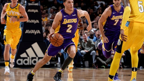 DENVER, CO - DECEMBER 2: Lonzo Ball #2 of the Los Angeles Lakers handles the ball against the Denver Nuggets on December 2, 2017 at the Pepsi Center in Denver, Colorado. NOTE TO USER: User expressly acknowledges and agrees that, by downloading and/or using this Photograph, user is consenting to the terms and conditions of the Getty Images License Agreement. Mandatory Copyright Notice: Copyright 2017 NBAE (Photo by Bart Young/NBAE via Getty Images)