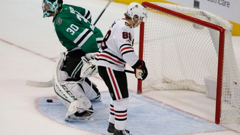 Dallas Stars goalie Ben Bishop (30) stops a shot by Chicago Blackhawks right wing Patrick Kane (88) during the shootout in an NHL hockey game, Saturday, Dec. 2, 2017, in Dallas. The Stars defeated the Blackhawks 3-2. (AP Photo/ Michael Ainsworth)