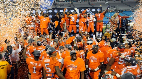 Clemson players celebrate after winning the Atlantic Coast Conference championship NCAA college football game against Miami in Charlotte, N.C., Saturday, Dec. 2, 2017. (AP Photo/Mike McCarn)