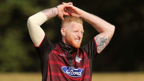 New Zealand-born England cricket player Ben Stokes reacts after bowling for provincial cricket team Canterbury in Rangiora, New Zealand, Sunday, Dec. 3, 2017. England allrounder Stokes made only 2 runs in his first cricket since September when he turned out for Canterbury against Otago in New Zealand's one-day competition on Sunday. (AP Photo/Martin Hunter)