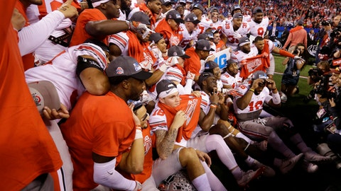 Ohio State players celebrate following the Big Ten championship NCAA college football game against Wisconsin, early Sunday, Dec. 3, 2017, in Indianapolis. Ohio State won 27-21. (AP Photo/Michael Conroy)