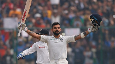 India's captain Virat Kohli celebrates after scoring a double century during the second day of their third test cricket match against Sri Lanka in New Delhi, India, Sunday, Dec. 3, 2017. (AP Photo/Altaf Qadri)