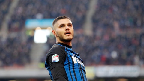 Inter Milan's Mauro Icardi celebrates after scoring during the Serie A soccer match between Inter Milan and Chievo Verona at the San Siro stadium in Milan, Italy, Sunday, Dec. 3, 2017. (AP Photo/Antonio Calanni)