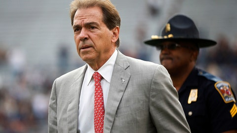 FILE - In this Nov. 25, 2017, file photo, Alabama head coach Nick Saban walks the field before the Iron Bowl NCAA college football game against Auburn, in Auburn, Ala. The Associated Press voters prefer Alabama over Ohio State. In the final Top 25 of the regular season, the Crimson Tide was No. 4 and the Buckeyes were No. 5. (AP Photo/Brynn Anderson, File)