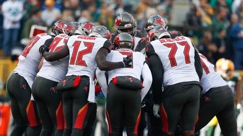 Tampa Bay Buccaneers quarterback Jameis Winston leads a huddle during the first half of an NFL football game against the Green Bay Packers Sunday, Dec. 3, 2017, in Green Bay, Wis. (AP Photo/Matt Ludtke)
