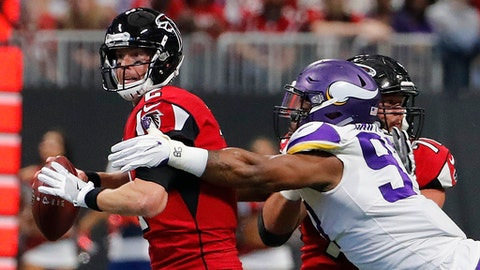 Minnesota Vikings defensive end Everson Griffen (97) hits Atlanta Falcons quarterback Matt Ryan (2) during the first half of an NFL football game, Sunday, Dec. 3, 2017, in Atlanta. (AP Photo/David Goldman)