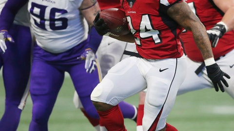 Atlanta Falcons running back Devonta Freeman (24) runs against the Minnesota Vikings during the first half of an NFL football game, Sunday, Dec. 3, 2017, in Atlanta. (AP Photo/John Bazemore)