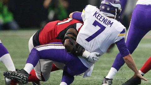Atlanta Falcons defensive tackle Grady Jarrett (97) sacks Minnesota Vikings quarterback Case Keenum (7) during the first half of an NFL football game, Sunday, Dec. 3, 2017, in Atlanta. (AP Photo/John Bazemore)