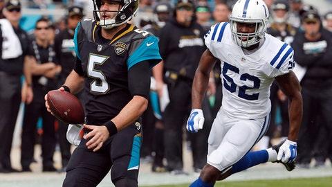 Jacksonville Jaguars quarterback Blake Bortles (5) scrambles for yardage past Indianapolis Colts outside linebacker Barkevious Mingo (52) during the first half of an NFL football game, Sunday, Dec. 3, 2017, in Jacksonville, Fla. (AP Photo/Stephen B. Morton)