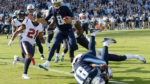 Tennessee Titans quarterback Marcus Mariota (8) leaps over tight end Jonnu Smith (81) as Mariota scores a touchdown on a 9-yard run against the Houston Texans in the first half of an NFL football game Sunday, Dec. 3, 2017, in Nashville, Tenn. (AP Photo/Mark Zaleski)